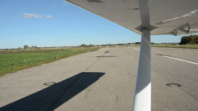 Aircraft wing vibration and shadow on aerodrome stock video