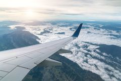 Aircraft wing view from airplane window seat Going to the mounta. Ins Royalty Free Stock Image