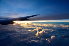 Aircraft wings above the clouds.Horizontal view. Stock Photos