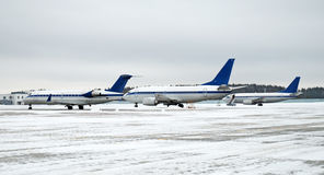 Aircrafts. Planes on frozen winter airfield stock photo