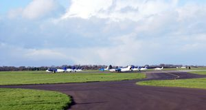 Aircrafts in an airport. Aerial transportation. Aircrafts in an airport Royalty Free Stock Photography