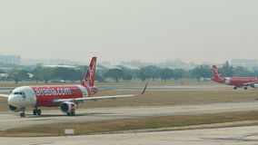 Aircrafts Airport Air Asia Travel 4k. KUALA LUMPUR, MALAYSIA - MARCH, 2017: recently landed aircrafts of Air Asia airline at the airport of Kuala Lumpur stock video