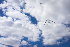Aircrafts. 10 aircrafts as a triangle in a sky Stock Images