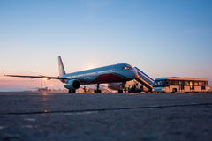 Aircrafts on the early morning airport apron Royalty Free Stock Photo