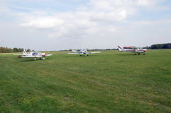 Aircrafts on a grass airfield. Small aircrafts on a grass airfield stock photos