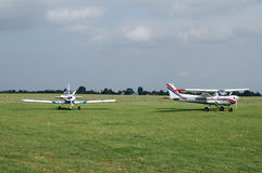 Aircrafts on a grass airfield. Small aircrafts on a grass airfield stock photography