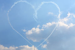 Aircrafts paint big heart of smoke. ZHUKOVSKY - AUGUST 12: Aircrafts paint big heart of smoke at airshow on 100th anniversary of Russian Air Force on August 12 Stock Photos