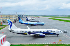 Aircrafts at the parking in Pulkovo International airport in Saint-Petersburg, Russia Royalty Free Stock Images