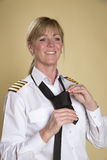 Aircrew captain adjusting uniform tie Royalty Free Stock Photo