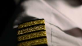 Aircrew captain at work, closeup of pilot's shirt epaulets, career in aviation. Stock footage stock footage