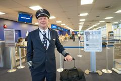 Aircrew. NEW YORK - MARCH 14, 2016: pilot in JFK airport. John F. Kennedy International Airport is a major international airport located in the Queens borough of royalty free stock image