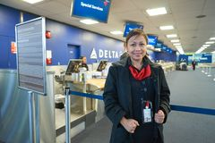 Aircrew. NEW YORK - MARCH 14, 2016: stewardess in JFK airport. John F. Kennedy International Airport is a major international airport located in the Queens Royalty Free Stock Photo