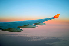 Aircrfat's wing. Beauty susnet during long flight Stock Photography