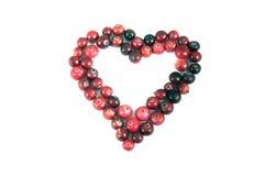 Airela vermelha madura da forma do coração sobre o branco Foto de Stock Royalty Free