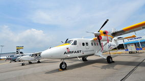 Airfast Indonesia Viking's Twin Otter Series 400 and GippsAero GA8 Airvan on display at Singapore Airshow Royalty Free Stock Photos