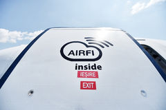Airfi system sign imprinted on airplane door Royalty Free Stock Image