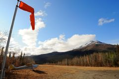 Airfield with an aircraft and a windsock Royalty Free Stock Photography