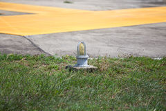Airfield light sign. Light sign on helipad for safety flight and landing Royalty Free Stock Photo