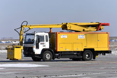 The airfield machine serves an airplane. Rostov-on-Don, russia, on January 28, 2017 Royalty Free Stock Photo