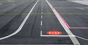 Airfield runway with signs. Stock Photography