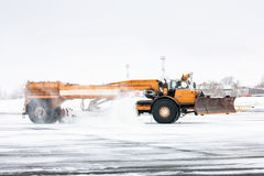 Airfield sweeper cleans the Runway. In a cold winter airport Royalty Free Stock Image