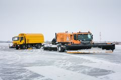 Airfield sweeper-vacuum machine and snowblower universal cleaning truck on the runway. Airfield sweeper-vacuum machine and snowblower universal cleaning truck on Royalty Free Stock Images