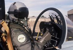 Airforce pilot in cockpit. RAAF pilot give thumbs up before take off. Royal Australian Air Force pilot in helmet with black visor Royalty Free Stock Images