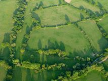 Green fields and trees seen from above stock photography