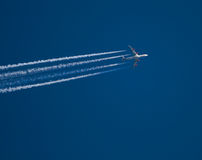 Airjet. Airplane at the blue sky Royalty Free Stock Photography