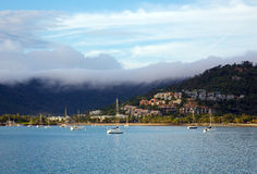 Airlie Beach in Queensland Australia. Early morning landscape showing seaside town of Airlie Beach in Queensland Australia Stock Photo