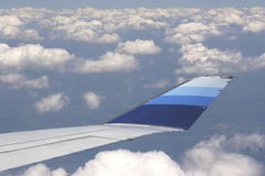 Airline. Flying above cloudy sky Royalty Free Stock Photography
