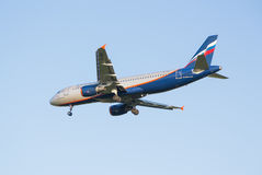 The airline Airbus A320 plane Aeroflot descending at the Sheremetyevo airport Royalty Free Stock Images
