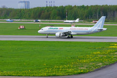 Airline Alitalia Airbus A320-216 aircraft is landing in Pulkovo International airport in Saint-Petersburg, Russia Stock Images