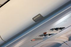 airline bin overhead storage Στοκ Φωτογραφίες