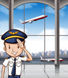 Airline captain at airport Royalty Free Stock Photography