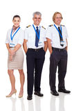Airline captain crew. Happy senior airline captain and crew isolated on white background royalty free stock photo