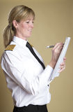Airline captain making notes Stock Photography