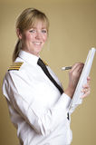 Airline captain making notes Royalty Free Stock Photography