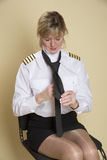 Airline captain tying tie Stock Photos