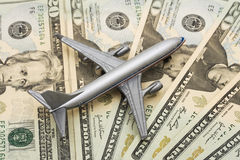 Airline Costs. Airplane on Money, the rising costs of airline travel Royalty Free Stock Photos