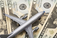Airline Costs. Airplane on Money, the rising costs of airline travel stock photography