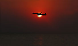 Airline flying in the sky at night Royalty Free Stock Photo