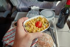 Airline food consumed. Airplane food tray after eating in flight royalty free stock image