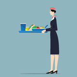 Airline hostess serving food. Royalty Free Stock Photo