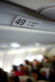 Airline interior. Interior view of airplane with aisle and seat numbers Royalty Free Stock Photos