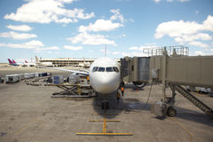 Airline Jet parked in Terminal Stock Photo