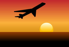 Airline jet silhouette takeoff into sunset or dawn. An airline jet silhouette takes off and climbs into a sunset or dawn Royalty Free Stock Photos