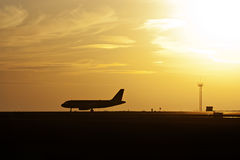 Airline Landing against Sunrise Stock Images