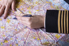 Airline officer with map and pen Royalty Free Stock Photos