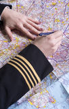 Airline officer planning a route Stock Photo